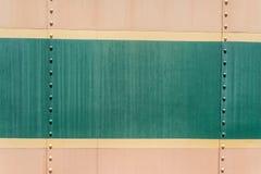 Alte Hintergrundbeschaffenheit der Creme und des Metalls des Grüns Stockfotografie
