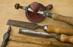 Alte Holzarbeit- und Zimmereihilfsmittel. Lizenzfreie Stockfotos