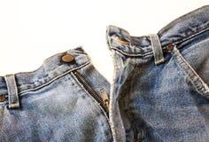 Alte Jeans getrennt stockbilder