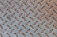 Alte karierte Stahlplatte oder alte Metalldiamantplatte mit rostigem Lizenzfreies Stockbild