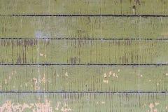 Alte kleine hölzerne Bretter mit der Schale der grünen Farbe Lizenzfreie Stockfotografie