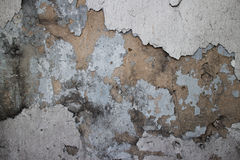 Alte Kolonialwand in Asien mit fehlendem Stuck, abgebrochene Farbe, Lizenzfreie Stockfotos