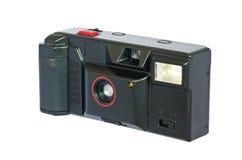 Alte kompakte Weinlesekamera gegen weißen Hintergrund. Stockfoto