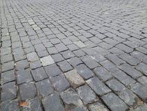 Alte Kopfsteinstraßen-Hintergrundbeschaffenheit Stockfotos