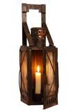 Alte Lampe mit brennender Kerze Stockbild