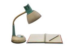 Alte Lampe mit dem Buch Stockfoto