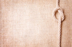 Alte Leinwand und Knoten Stockfotos
