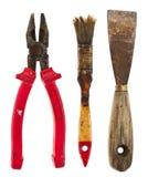 Alte lokalisierte Werkzeuge: Kittmesser, Zangen, Bürste Lizenzfreie Stockfotos