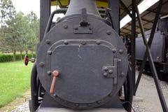 Alte Lokomotiven und Lastwagen Stockfotografie