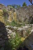 Alte Mühlruinen im Bereich der heißen Quellen von Bagno Vignoni Lizenzfreies Stockfoto