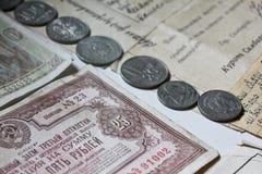 Alte Münzen und Banknoten Lizenzfreies Stockbild
