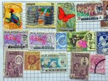 Alte malaiische Briefmarken stockfotos
