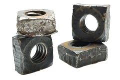 Alte Metallmaschinen-Muttern Stockfoto