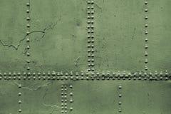 Alte militärische grüne Blechtafeln mit Niet Lizenzfreies Stockfoto