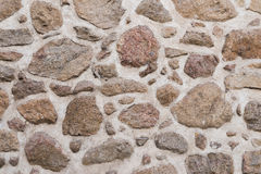 Alte mittelalterliche Wand des Steins und des Ziegelsteines Lizenzfreie Stockbilder