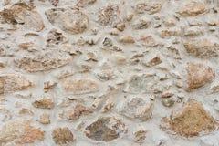 Alte mittelalterliche Wand des Steins und des Ziegelsteines Lizenzfreie Stockfotos