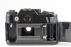 Alte 35mm SLR Kamera mit Abdeckung des offenen Rückens Lizenzfreie Stockbilder