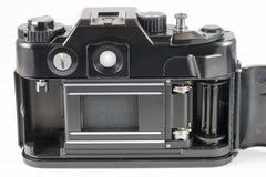 Alte 35mm SLR Kamera mit Abdeckung des offenen Rückens Lizenzfreie Stockfotografie