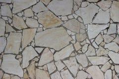 Alte Mosaikwand von beige Blöcken der Jerusalem-Steinbeschaffenheit Stockfoto