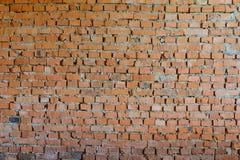 Alte nachlässige Backsteinmauer Stockfoto