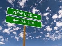 Alte oder neue Leben-Landstraßen-Zeichen Stockbild