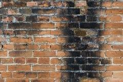 Alte orange Backsteinmauerbeschaffenheiten und -hintergründe Stockbild