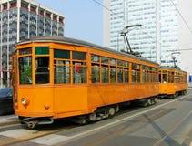 Alte orange Förderwagen in Mailand Stockfotografie