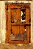 Alte orange Tür Stockbilder