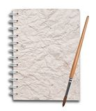 Alte Papiere des Notizbuches mit Lackpinsel Stockfoto