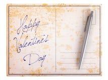Alte Papierpostkarte - glücklicher Valentinsgrußtag Stockbild