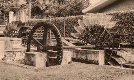 Alte Räder eines watermill Weinleseartbild Addieren von Korn t Stockbild