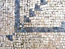 Alte römische blaue und weiße Mosaikfußbodenfliesen im archäologischen Bereich Lizenzfreie Stockfotos
