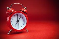 Alte Retro- rote Uhr Stockfoto