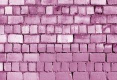 Alte rosa getonte Backsteinmauerbeschaffenheit Stockbild
