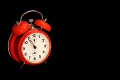 Alte rote Alarmuhr Lizenzfreie Stockfotos