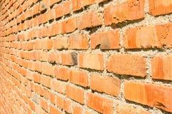 Alte rote Backsteinmauerbeschaffenheit Stockbild