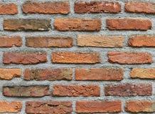 Alte rote Block- und Betonmauerbeschaffenheit Stockfotos