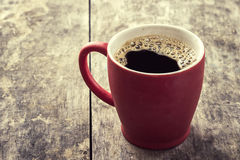 Alte rote Kaffeetasse Stockfoto