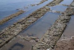 Alte Ruinen im Meer Stockfotos