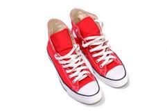 Alte scarpe da tennis superiori rosse Fotografia Stock