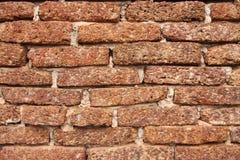 Alte Schmutz Laterite-Backsteinmauerbeschaffenheit für Hintergrund Stockfotos