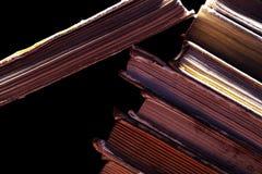 Alte schmutzige Bücher auf dem Schwarzen Lizenzfreie Stockfotografie