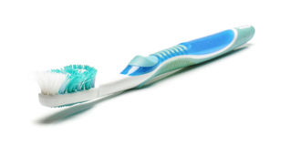 Alte schmutzige benutzte Zahnbürste lokalisiert auf dem weißen Hintergrund Lizenzfreies Stockbild