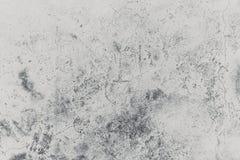 Alte Schmutzsprungs-Graubetonmauer Stockfoto