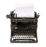 Alte Schreibmaschine mit einem unbelegten Papier Lizenzfreie Stockfotos