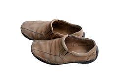 Alte Schuhe auf einem weißen Hintergrund Stockbilder