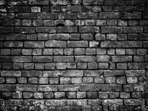 Alte schwarze Backsteinmauer, Steinbeschaffenheit für Hintergrunddesign Lizenzfreie Stockfotografie