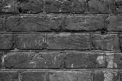 Alte schwarze Backsteinmauerbeschaffenheit für Hintergrund Stockfotografie