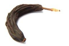 Alte schwarze Banane lokalisiert Stockfoto