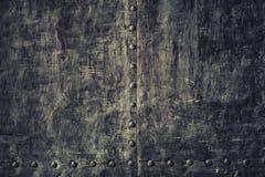 Alte schwarze Metallplatte des Nahaufnahmeschmutzes als Hintergrundbeschaffenheit Stockbilder